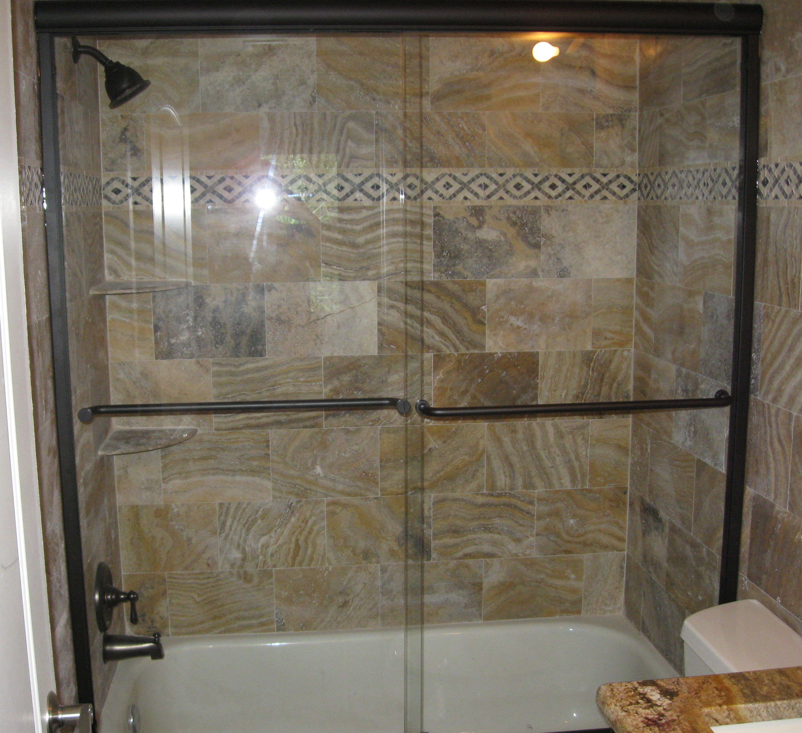 semi frameless sliding shower doors. semi-frameless tub slider, oil rub bronze hardware, clear glass semi frameless sliding shower doors a